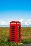 Red phone booth in landscape V2. Red phone booth standing alone in landscape Stock Photo