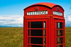 Red phone booth in landscape V4 Stock Photo