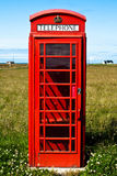 Red phone booth in landscape V5. Red phone booth standing alone in landscape Royalty Free Stock Images