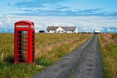 Red phone booth in landscape V6 Stock Image