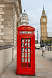 Red phone booth. London, England. Red telephone box and Big Ben. London, England Royalty Free Stock Photo