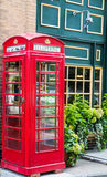 Red Phone Booth Outside Pub Royalty Free Stock Photography
