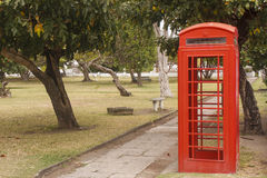 Red Phone Booth in Public Park Royalty Free Stock Photo