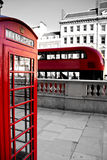 Red phone booth and red bus Royalty Free Stock Photo