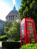 Red phone booth and St. Pauls Cathedral in London stock images