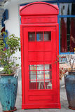 The red phone booth Stock Photography