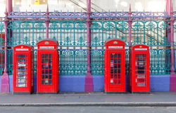 Red Phone Booths. Traditional British red phone booths in a row at an old market in London stock photo