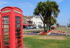 Red phone box Deal England. Red telephone booth on Strand street in Deal town, Kent, England which lies on the English Channel, eight miles north-east of Dover stock photography