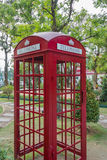 Red phone box. Is located in the park Royalty Free Stock Photo