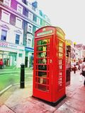 Red phone box in London. Public red phone box in London, England Royalty Free Stock Images