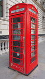 Red phone box in London. Traditional red telephone box in London, UK Royalty Free Stock Images