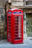 Red Phone Box Malta. Vintage English red phone box on the streets of Valetta, Malta Stock Photos