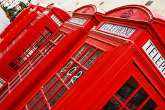 Red phone boxes. Five red phone boxes, angled composition stock photos