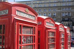 Red phone boxes. A row of red telephone boxes in London Stock Photo
