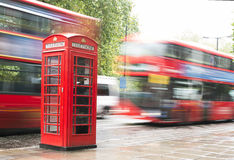 Red Phone cabine and bus in London. Royalty Free Stock Photography