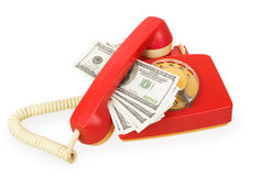 Red phone and dollars Stock Images