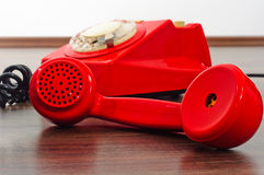 Red phone on floor Stock Photography