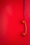 Red phone hanging Stock Photos