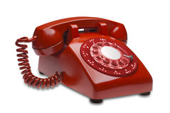 Red phone, isolated. Red angled 60s rotary dial phone isolated with clipping path Stock Photos