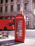 Red Phone in London. Red Phone, Red Double Bus and Red... All English Stock Image