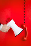 Red phone and megaphone Royalty Free Stock Images
