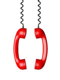 Red phone receivers hanging Royalty Free Stock Photography