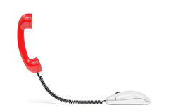 Red phone reciever connected to the computer mouse. Service comm Stock Image