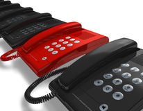 Red phone within row of black ones Royalty Free Stock Image