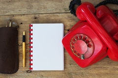 Red Phone on Table Royalty Free Stock Images