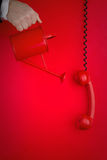 Red phone and wall Stock Photography