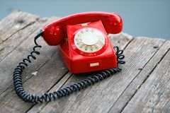 Red phone on wooden deck Stock Image