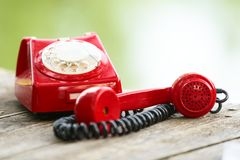 Red phone on wooden deck Stock Photo