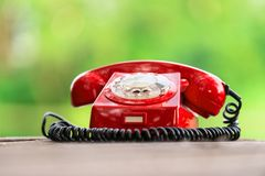 Red phone on wooden deck Stock Photography