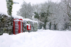 Red phonebox in the snow Royalty Free Stock Images