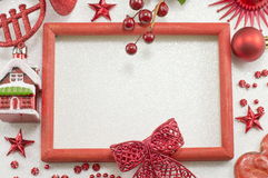 Red photo frame with Christmas decorations Stock Image