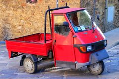 Free Red Piaggio Ape 50 In The Street Of Montalcino Town, Val D`Orcia Stock Images - 101714214