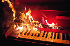 Red piano in orange flames Royalty Free Stock Photos
