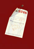 Red Pick-Up ticket on Laundry Bag Royalty Free Stock Image