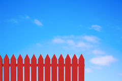 Red Picket Fence and Blue Sky Royalty Free Stock Images