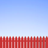 Red Picket Fence and Clear Blue Sky Royalty Free Stock Images