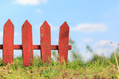 Red picket fence Stock Photo