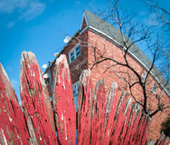 Red picket fence warped fisheye Stock Images