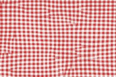Red picnic blanket fabric with squared patterns and texture royalty free illustration