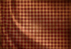 Red picnic cloth. Grunge red picnic cloth with some folds Royalty Free Stock Image