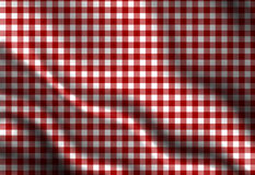 Red picnic cloth. With some folds in it Stock Photo