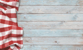 Red picnic cloth on blue wood table stock photo