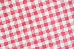 Red picnic tablecloth background, checkered fabric texture. Stock Images