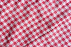 Red picnic  tablecloth background. Royalty Free Stock Photo