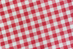 Red picnic  tablecloth background. Stock Image
