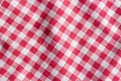 Red picnic tablecloth background. Stock Photo